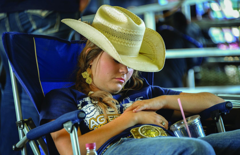 Sleeping cowgirl, Titus County Fair, October 2014